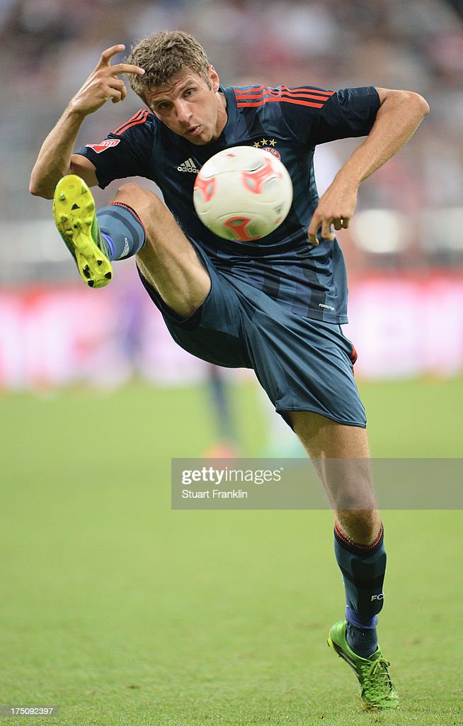 <a gi-track='captionPersonalityLinkClicked' href=/galleries/search?phrase=Thomas+Mueller&family=editorial&specificpeople=5842906 ng-click='$event.stopPropagation()'>Thomas Mueller</a> of Muenchen in action during the Audi cup match between FC Bayern Muenchen and FC Sao Paulo at Allianz Arena on July 31, 2013 in Munich, Germany.