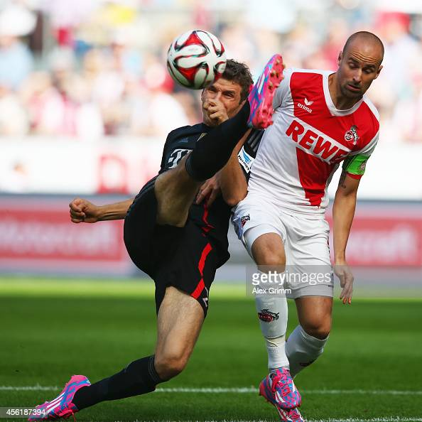 Thomas Mueller of Muenchen is challenged by Miso Brecko of Koeln during the Bundesliga match between 1 FC Koeln and FC Bayern Muenchen at...