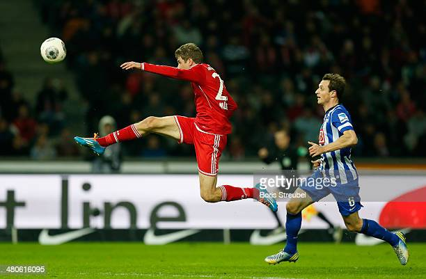 Thomas Mueller of Muenchen jumps for a ball during the Bundesliga match between Hertha BSC and FC Bayern Muenchen at Olympiastadion on March 25 2014...