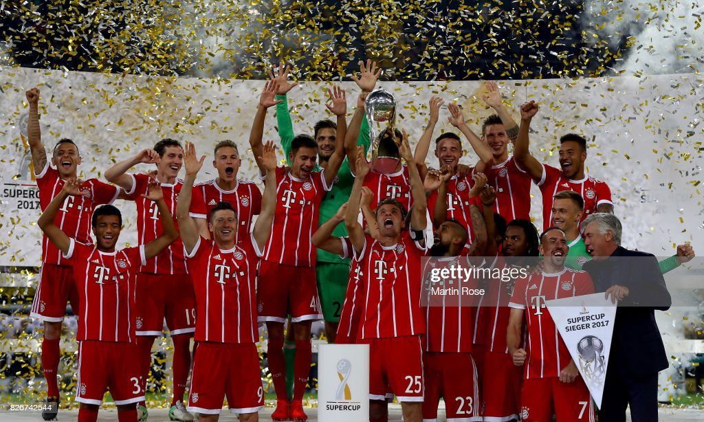 Thomas Mueller (C) of Muenchen lifts the super cup trophy after the DFL Supercup 2017 match between Borussia Dortmund and Bayern Muenchen at Signal Iduna Park on August 5, 2017 in Dortmund, Germany.