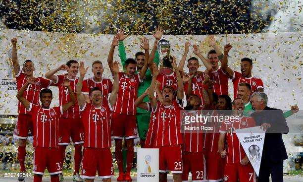 Thomas Mueller of Muenchen lifts the super cup trophy after the DFL Supercup 2017 match between Borussia Dortmund and Bayern Muenchen at Signal Iduna...