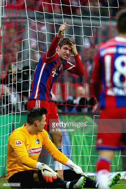 Thomas Mueller of Muenchen reacts after scoring the second team goal against Roman Buerki keeper of Freiburg during the Bundesliga match between FC...