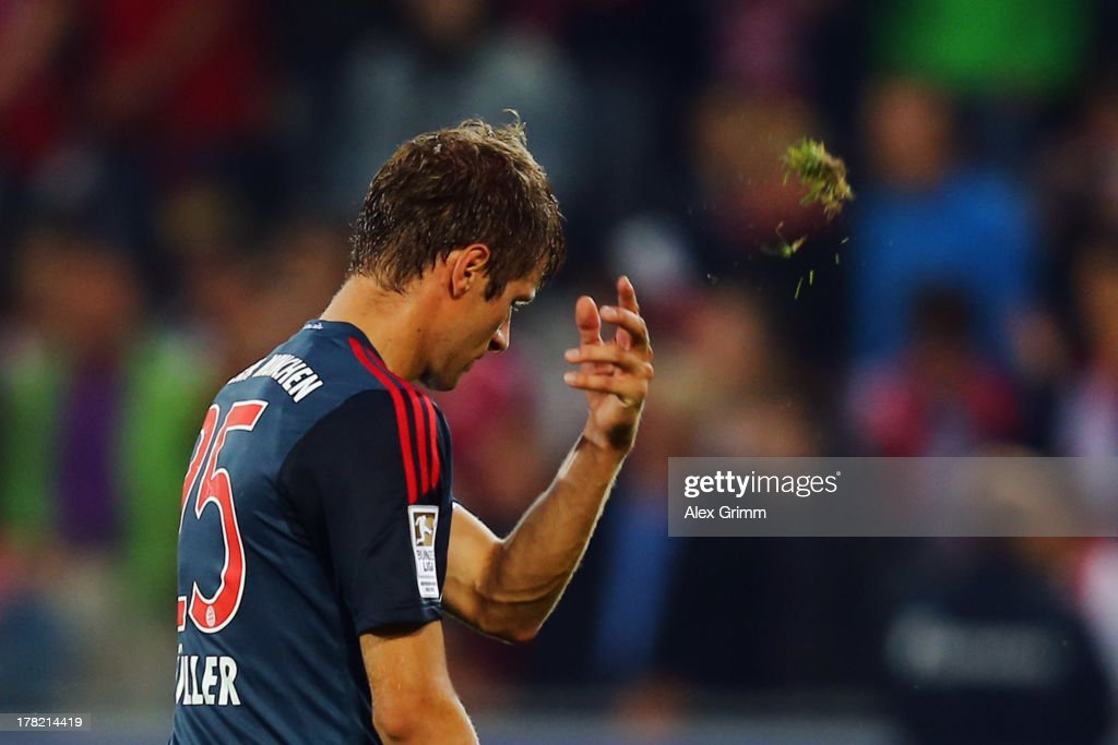 <a gi-track='captionPersonalityLinkClicked' href=/galleries/search?phrase=Thomas+Mueller&family=editorial&specificpeople=5842906 ng-click='$event.stopPropagation()'>Thomas Mueller</a> of Muenchen reacts after the Bundesliga match between SC Freiburg and FC Bayern Muenchen at MAGE SOLAR Stadium on August 27, 2013 in Freiburg im Breisgau, Germany.