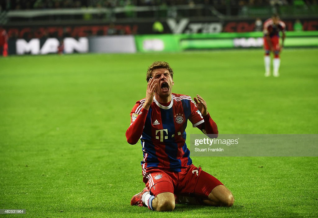 <a gi-track='captionPersonalityLinkClicked' href=/galleries/search?phrase=Thomas+Mueller&family=editorial&specificpeople=5842906 ng-click='$event.stopPropagation()'>Thomas Mueller</a> of Muenchen reacts during the Bundesliga match between VfL Wolfsburg and FC Bayern Muenchen at Volkswagen Arena on January 30, 2015 in Wolfsburg, Germany.