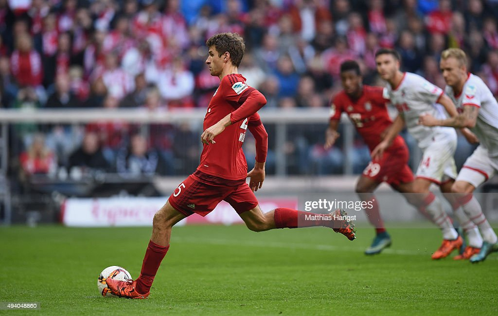 Thomas Mueller of Muenchen scores his team's fourth goal by penalty during the Bundesliga match between FC Bayern Muenchen and 1. FC Koeln at Allianz Arena on October 24, 2015 in Munich, Germany.
