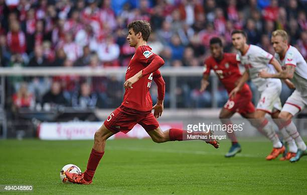 Thomas Mueller of Muenchen scores his team's fourth goal by penalty during the Bundesliga match between FC Bayern Muenchen and 1 FC Koeln at Allianz...