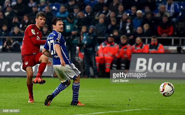 Thomas Mueller of Muenchen scores his teams third goal during the Bundesliga match between FC Schalke 04 and FC Bayern Muenchen at VeltinsArena on...