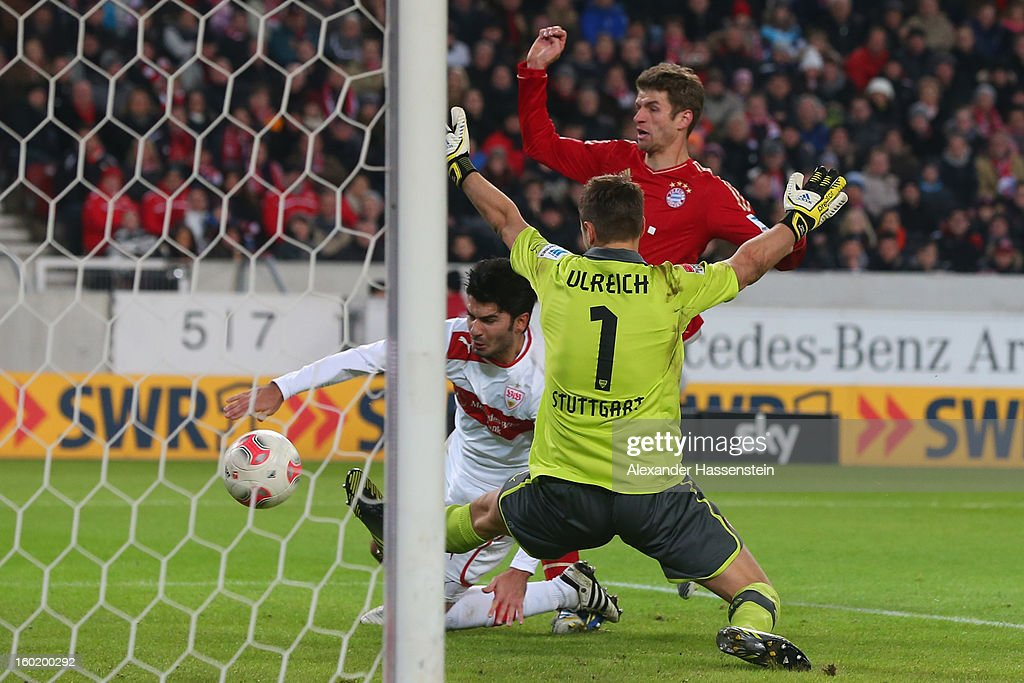 Thomas Mueller (C) of Muenchen scores the 2nd team goal against <a gi-track='captionPersonalityLinkClicked' href=/galleries/search?phrase=Sven+Ulreich&family=editorial&specificpeople=4877030 ng-click='$event.stopPropagation()'>Sven Ulreich</a>, keeper of Stuttgart and his team mate <a gi-track='captionPersonalityLinkClicked' href=/galleries/search?phrase=Serdar+Tasci&family=editorial&specificpeople=787688 ng-click='$event.stopPropagation()'>Serdar Tasci</a> (C) during the Bundesliga match between VfB Stuttgart and FC Bayern Muenchen at Mercedes-Benz Arena on January 27, 2013 in Stuttgart, Germany.