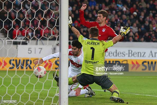 Thomas Mueller of Muenchen scores the 2nd team goal against Sven Ulreich keeper of Stuttgart and his team mate Serdar Tasci during the Bundesliga...