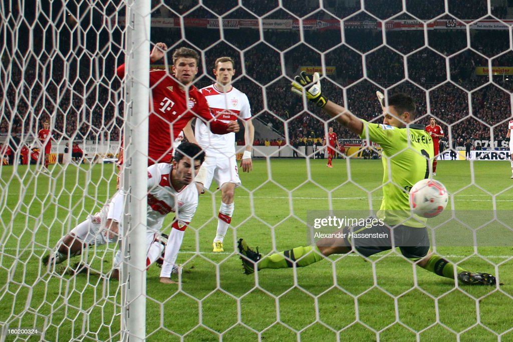 Thomas Mueller (L) of Muenchen scores the 2nd team goal against Sven Ulreich, keeper of Stuttgart and his team mate Serdar Tasci during the Bundesliga match between VfB Stuttgart and FC Bayern Muenchen at Mercedes-Benz Arena on January 27, 2013 in Stuttgart, Germany.