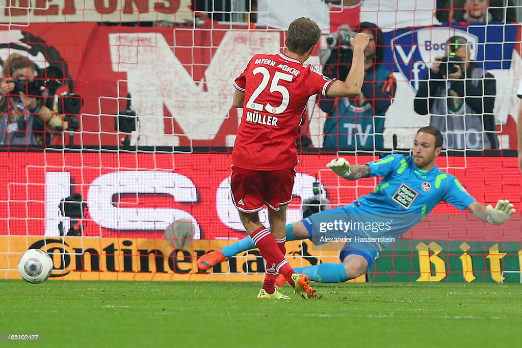 Thomas Mueller of Muenchen scores the 3rd team goal with a penalty against Tobias Sippel keeper of Kaiserslautern during the DFB Cup semi final match...