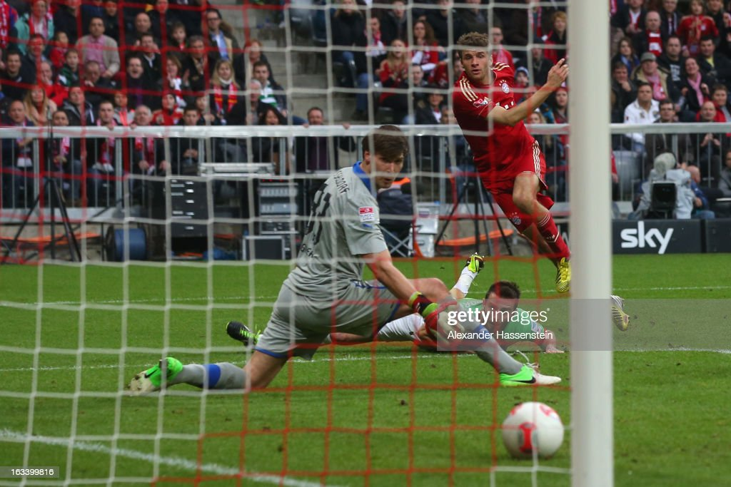 Thomas Mueller of Muenchen scores the first team goal against Fabian Giefer, keeper of Duesseldorf during the Bundesliga match between FC Bayern Muenchen and Fortuna Duesseldorf 1895 at Allianz Arena on March 9, 2013 in Munich, Germany.