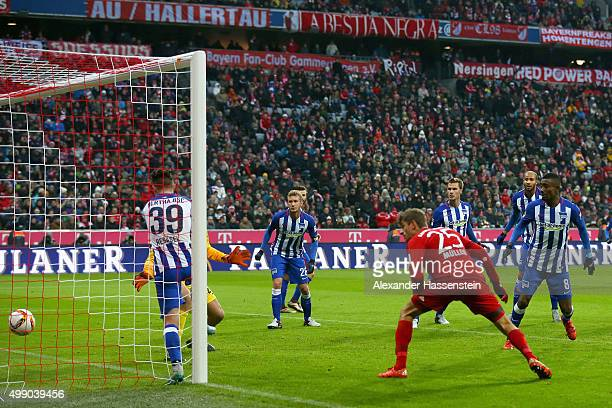 Thomas Mueller of Muenchen scores the opening goal during the Bundesliga match between FC Bayern Muenchen and Herha BSC Berlin at Allianz Arena on...