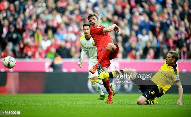 Thomas Mueller of Muenchen scores the opening/first goal during the Bundesliga match between FC Bayern Muenchen and Borussia Dortmund at Allianz...