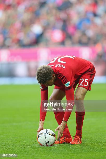 Thomas Mueller of Muenchen walks with the ball during the Bundesliga match between FC Bayern Muenchen and 1 FC Koeln at Allianz Arena on October 24...