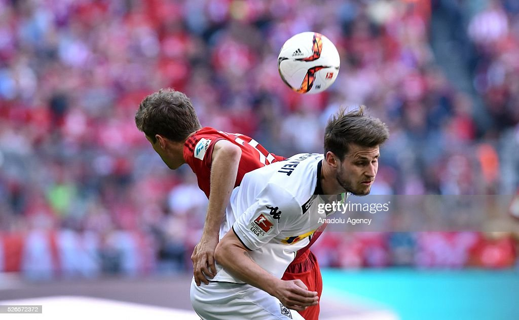 Thomas Mueller (L) of Munich and Havard Nordtveit of Moenchengladbach fight for the ball during the Bundesliga soccer match between Bayern Munich and Borussia Moenchengladbach at the Allianz Arena in Munich, Germany on April 30, 2016.