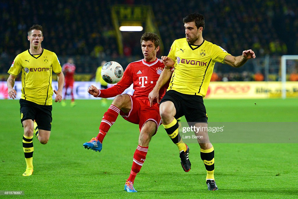 <a gi-track='captionPersonalityLinkClicked' href=/galleries/search?phrase=Thomas+Mueller&family=editorial&specificpeople=5842906 ng-click='$event.stopPropagation()'>Thomas Mueller</a> of Munich challenges <a gi-track='captionPersonalityLinkClicked' href=/galleries/search?phrase=Sokratis+Papastathopoulos+-+Soccer+Player&family=editorial&specificpeople=4426771 ng-click='$event.stopPropagation()'>Sokratis Papastathopoulos</a> of Dortmund during the Bundesliga match between Borussia Dortmund and FC Bayern Muenchen at Signal Iduna Park on November 23, 2013 in Dortmund, Germany.