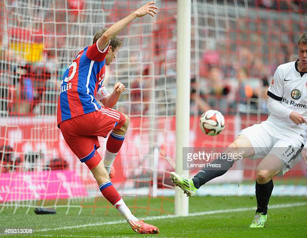Thomas Mueller of Munich scores his team's third goal during the Bundesliga match between FC Bayern Muenchen and Eintracht Frankfurt at Allianz Arena...