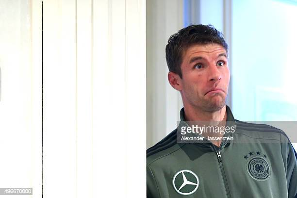 Thomas Mueller of the German national team jokes prior to a press conference at Hilton Hotel Tucher Park on November 11 2015 in Munich Germany
