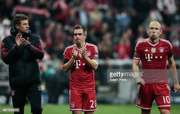 Thomas Mueller Philipp Lahm and Arjen Robben of Bayern Muenchen are dejected after losing the UEFA Champions League semifinal second leg match...