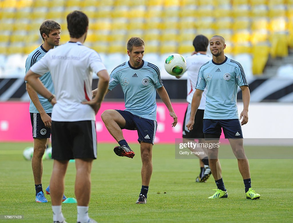 Thomas Mueller, Philipp Lahm and Sidney Sam of Germany in action during a Germany Training Session at Allianz Arena Munich on September 5, 2013 in Munich, Germany.