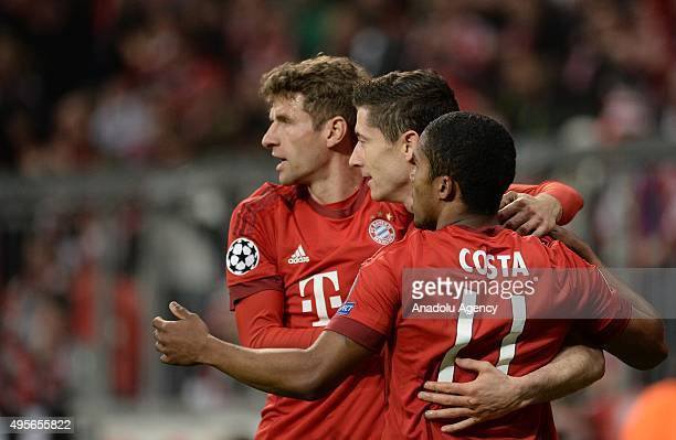 Thomas Mueller Robert Lewandowski and Douglas Costa of Bayern Munich celebrate a goal during the UEFA Champions League group F soccer match between...