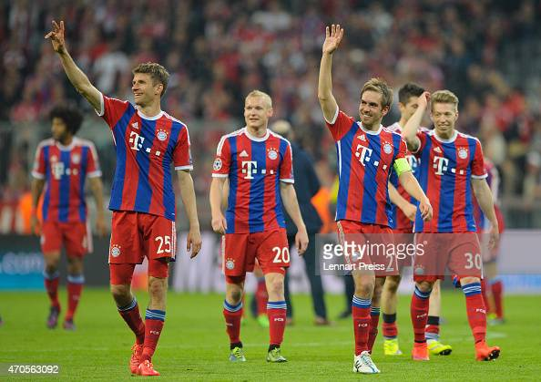 Thomas Mueller Sebastian Rode Philipp Lahm and Michell Weiser of Munich celebrate after the UEFA Champions League quarter final second leg match...