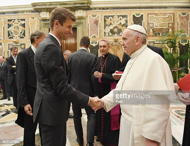 Thomas Mueller shakes hands with Pope Francis during a private audience with Pope Francis at the Vatican Palace on November 14 2016 in Vatican City...