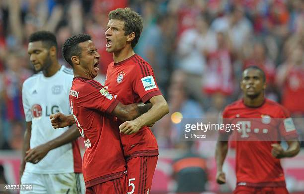 Thomas Mueller Thiago Alcantara and Douglas Costa of FC Bayern Muenchen celebrate their team's second goal during the Bundesliga match between FC...