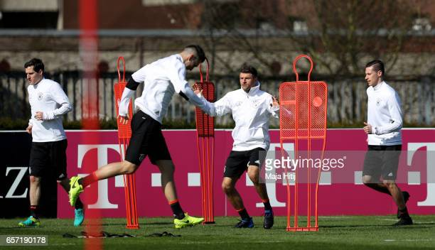 Thomas Mueller warms up with team mates during a Germany training session on March 24 2017 in Kamen Germany