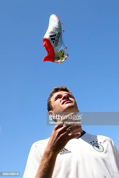 Thomas Mueller with his new Adidas football boots from the new Mercury Pack which were hand delivered by a skydive team on May 25 2016 in Ascona...