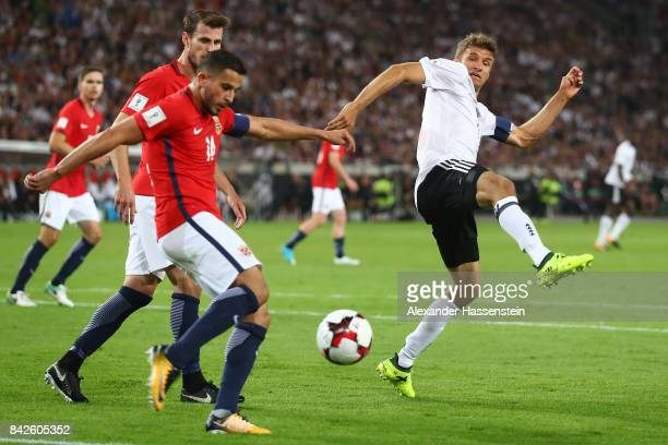 Thomas Muellerof Germany tries to block a shot by Omar Elabdellaoui of Norway during the FIFA 2018 World Cup Qualifier between Germany and Norway at...