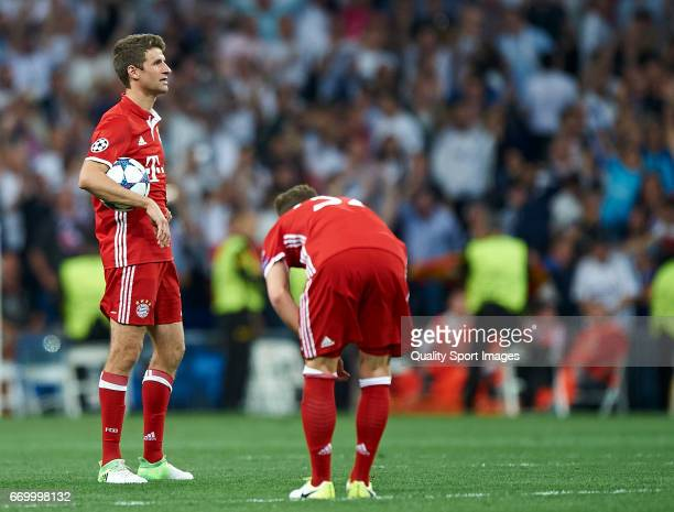 Thomas Muller and Joshua Kimmich of Bayern Muenchen reacts during the UEFA Champions League Quarter Final second leg match between Real Madrid CF and...