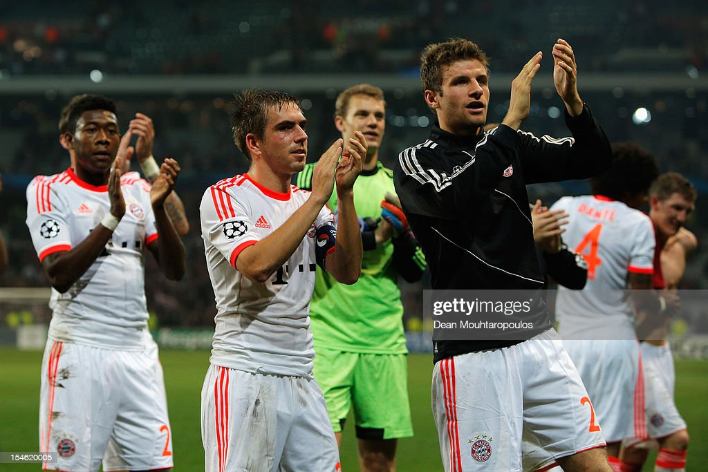Thomas Muller (#25) and <a gi-track='captionPersonalityLinkClicked' href=/galleries/search?phrase=Philipp+Lahm&family=editorial&specificpeople=483746 ng-click='$event.stopPropagation()'>Philipp Lahm</a> of Bayern Munich celebrate victory with the fans after the Group F UEFA Champions League match between OSC Lille and FC Bayern Muenchen at Grand Stade Lille Metropole on October 23, 2012 in Lille, France.