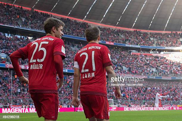 Thomas Muller and Philipp Lahm of Muenchen enters the field for the Bundesliga match between FC Bayern Muenchen and 1 FC Koeln at Allianz Arena on...