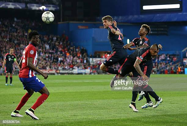 Thomas Muller Arturo Vidal and David Alaba of Bayern Munich fight for the ball while Thomas Partey of Atletico Madrid looks on during the UEFA...