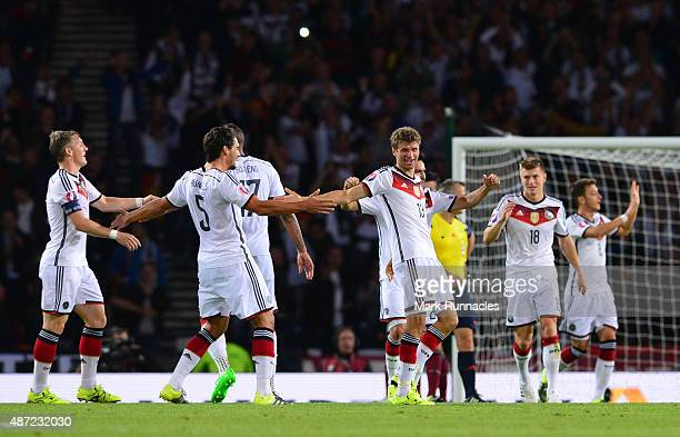 Thomas Muller celebrates with his team mates after the German second goal during the EURO 2016 Qualifier between Scotland and Germany at Hamden Park...
