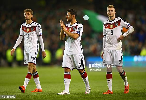 Thomas Muller Kevin Volland and Andre Schurrle of Germany applaud the fans after defeat in the UEFA EURO 2016 Qualifier group D match between...