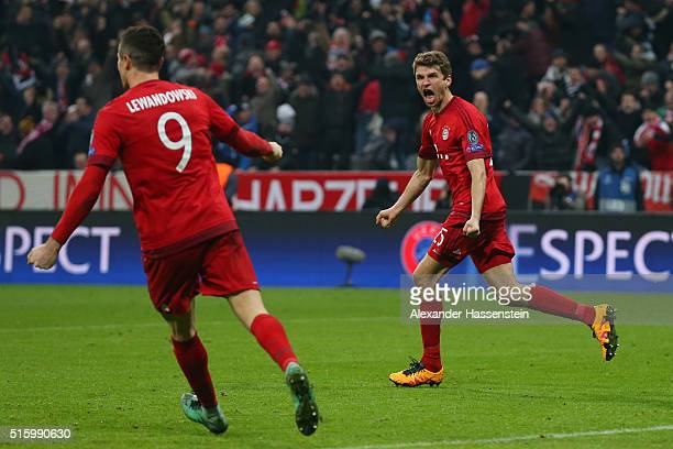 Thomas Muller of Bayern Muenchen celebrates scoring his team's second goal during the UEFA Champions League round of 16 second Leg match between FC...