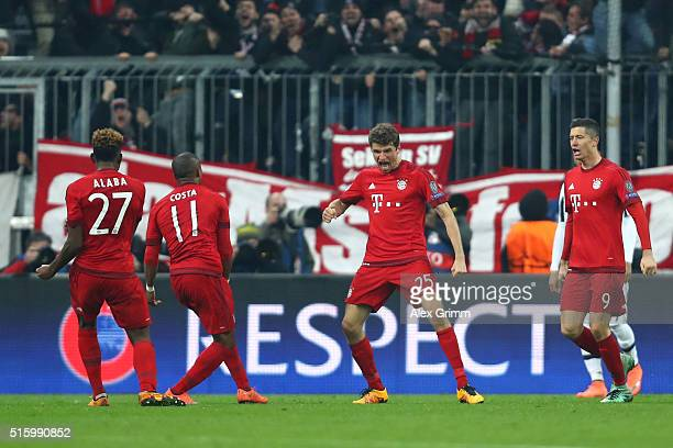 Thomas Muller of Bayern Muenchen celebrates scoring his team's second goal with his team mates Robert Lewandowski David Alaba and Douglas Costa...