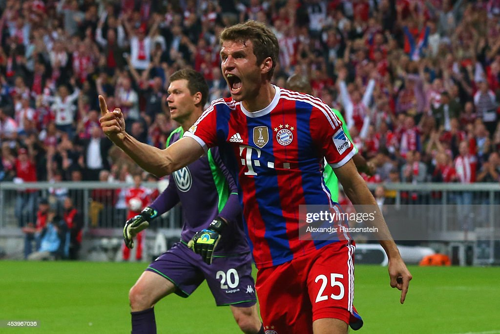 Thomas Muller of Bayern Muenchen celebrates scoring the first goal during the Bundesliga match between FC Bayern Muenchen and VfL Wolfsburg at Allianz Arena on August 22, 2014 in Munich, Germany.