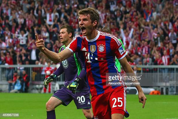 Thomas Muller of Bayern Muenchen celebrates scoring the first goal during the Bundesliga match between FC Bayern Muenchen and VfL Wolfsburg at...
