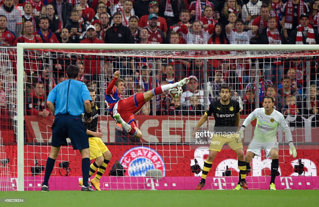 Thomas Muller of Bayern Muenchen has a shot on goal during the Bundesliga match between FC Bayern Muenchen and Borussia Dortmund at Allianz Arena on...