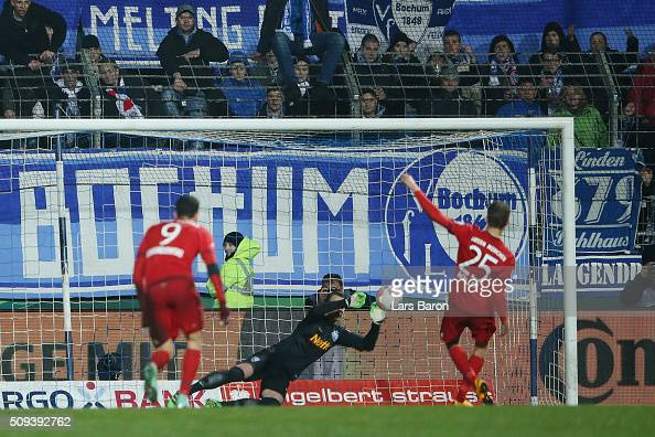 Thomas Muller of Bayern Muenchen has his penatly saved by Manuel Riemann of VfL Bochum during the DFB Cup quarter final match between VfL Bochum and...