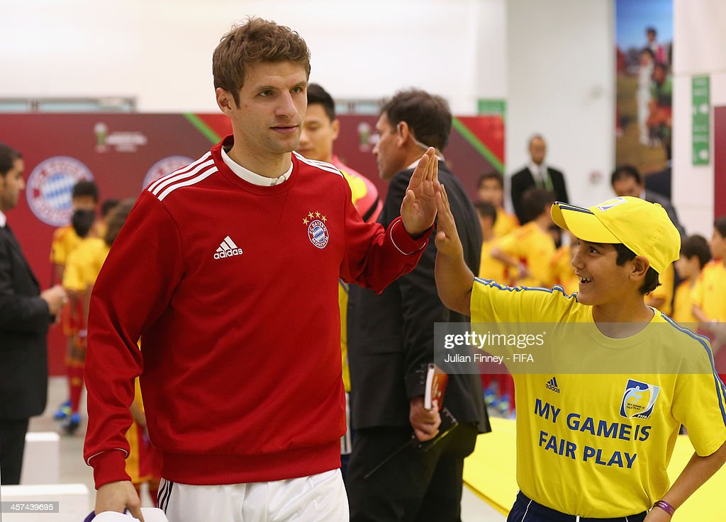 Thomas Muller of Bayern Muenchen hi fives a mascot before the FIFA Club World Cup Semi Final match between Guangzhou Evergrande FC and Bayern Muenchen at the Agadir Stadium on December 17, 2013 in Agadir, Morocco.