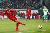 Thomas Muller of Bayern Muenchen shoots on goal during the DFB Cup match between VfL Wolfsburg and FC Bayern Muenchen at Volkswagen Arena on October...