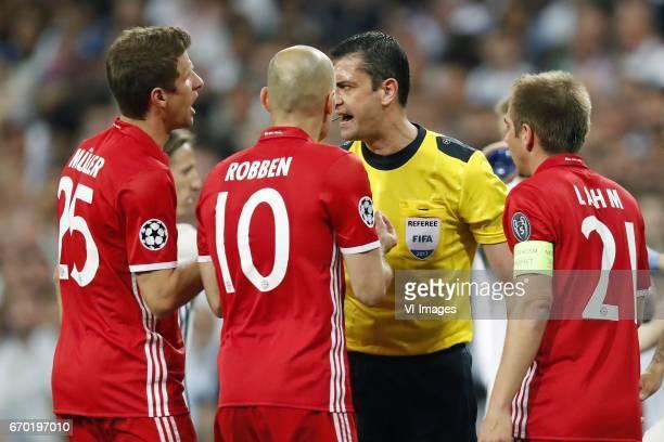 Thomas Muller of Bayern Munich Arjen Robben of Bayern Munich referee Viktor Kassai Philipp Lahm of Bayern Munichduring the UEFA Champions League...