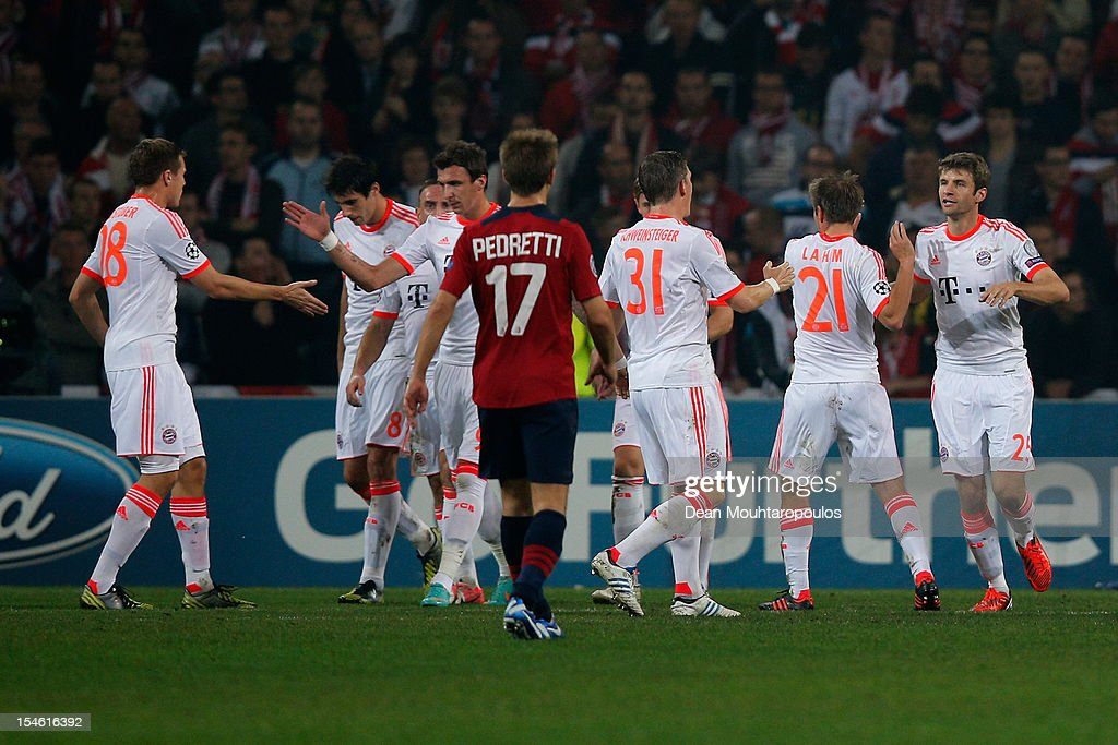 Thomas Muller (#25) of Bayern Munich celebrates scoring the first goal of the game from the penalty spot with team mates during the Group F UEFA Champions League match between OSC Lille and FC Bayern Muenchen at Grand Stade Lille Metropole on October 23, 2012 in Lille, France.