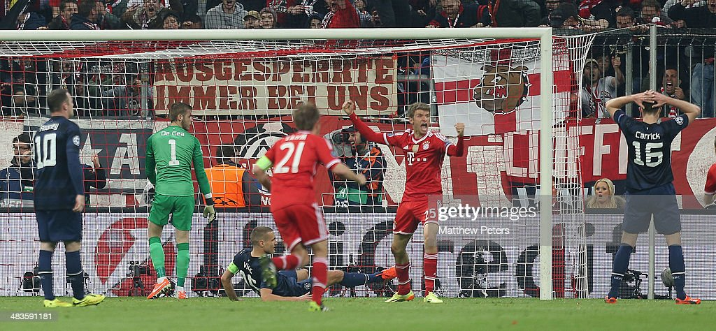 Thomas Muller of Bayern Munich celebrates scoring their second goal during the UEFA Champions League quarter-final second leg match between Bayern Munich and Manchester United at Allianz Arena on April 9, 2014 in Munich, Germany.