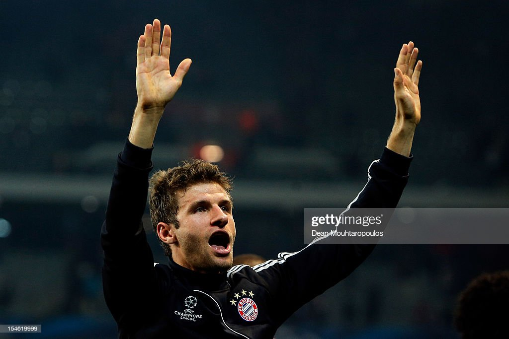 Thomas Muller (#25) of Bayern Munich celebrates victory with the fans after the Group F UEFA Champions League match between OSC Lille and FC Bayern Muenchen at Grand Stade Lille Metropole on October 23, 2012 in Lille, France.